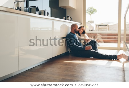 Laughing woman in kitchen Stock photo © nyul