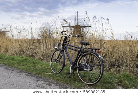 old type of bike and windmill stock photo © compuinfoto