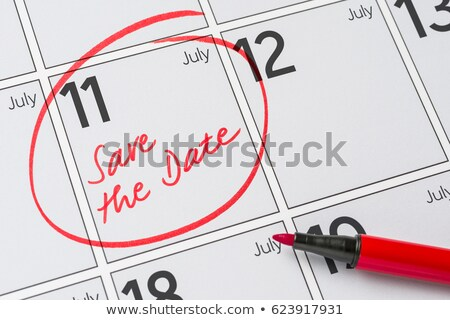 save the date written on a calendar   july 11 stock photo © zerbor