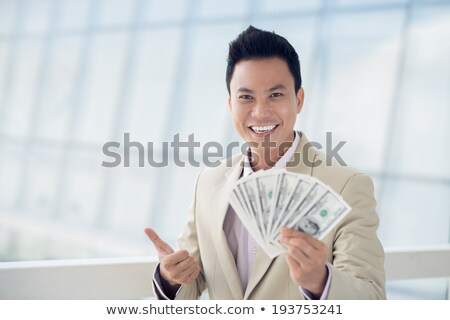 ázsiai örvend fiatal üzletember mutat hüvelykujj Stock fotó © NikoDzhi