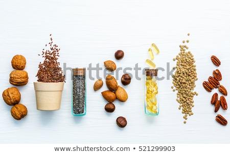 three cracked hazelnuts Stock photo © Digifoodstock