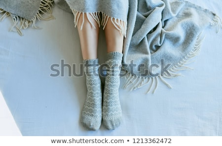 female feet stretching out of blanket stock photo © lightfieldstudios
