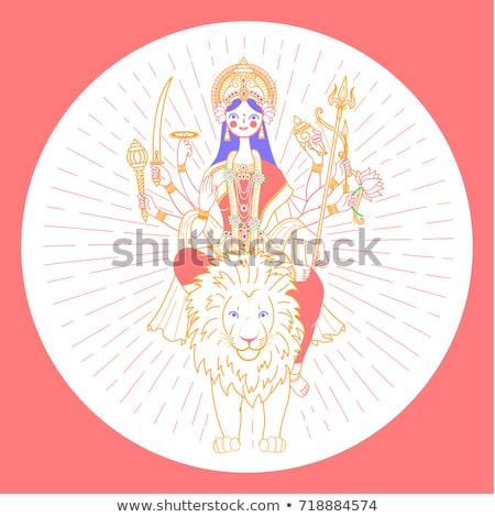Ikona bogini wiele ręce jazda konna lew Zdjęcia stock © Olena