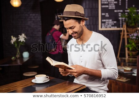 asian woman drinking coffee and reading newspaper stock photo © rastudio