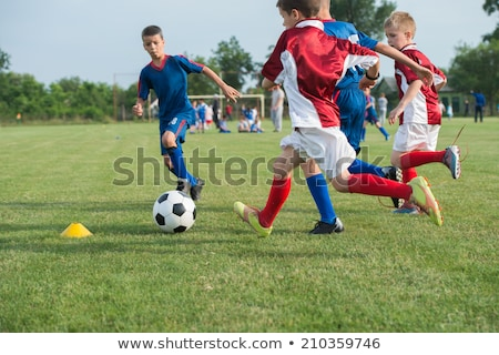 person running and playing soccer stock photo © is2