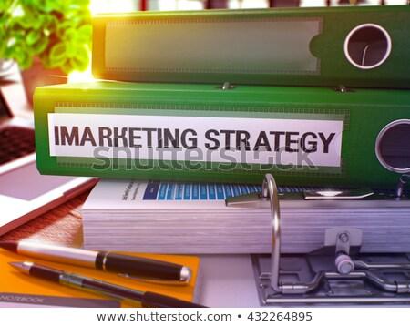 Green Office Folder with Inscription Imarketing Strategy. Stock photo © tashatuvango