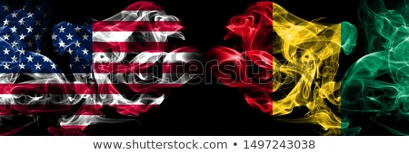 Football in flames with flag of guinea Stock photo © MikhailMishchenko