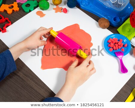 Young boy rolling dough with rolling pin Stock photo © IS2