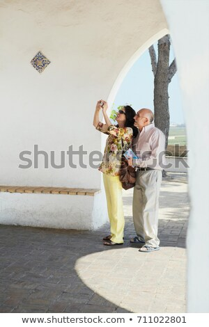 Older tourist couple taking a snapshot Stock photo © IS2