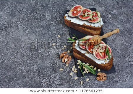bread toasted with goat cheese, walnut and honey Stock photo © M-studio