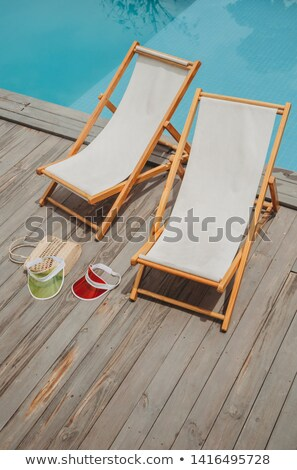Deck chairs by the poolside Stock photo © stevanovicigor