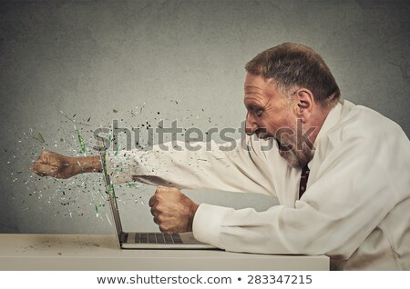 Empresário raiva computador retro Foto stock © studiostoks