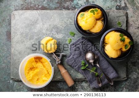 Sarı dondurma kaşık kepçe turuncu Stok fotoğraf © Digifoodstock