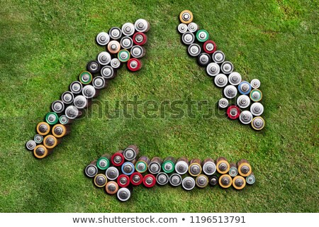 batteries showing arrow symbols on grass stock photo © andreypopov