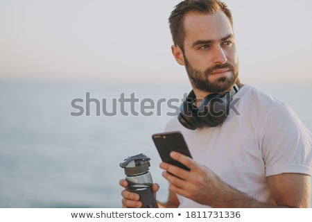 Homme smartphone plage fitness sport Photo stock © dolgachov