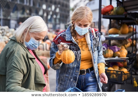 Senior woman buying gourd  on market Stock photo © boggy