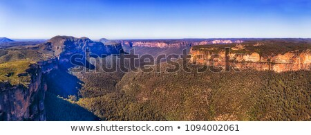 Luz solar arenito penhasco paredes azul montanhas Foto stock © lovleah