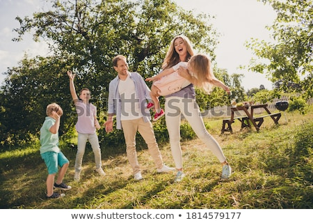 Family with three kids in the park Stock photo © colematt