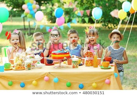 happy kids on birthday party at summer park stock photo © dolgachov