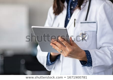 doctor using tablet stock photo © simazoran