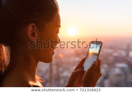 attractive woman looking at the asian sunset stock photo © majdansky