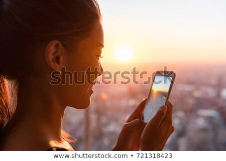 Regarder asian coucher du soleil belle femme Photo stock © majdansky