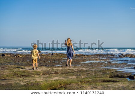 Mom and son are walking along the cosmic Bali beach.. Portrait travel tourists - mom with kids. Posi Stock photo © galitskaya
