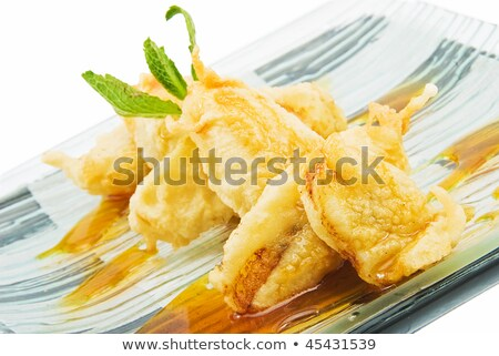 Plate with banana in tempura Stock photo © joannawnuk