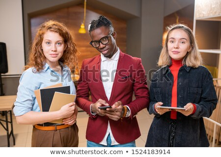row of three successful contemporary multicultural students of university stock photo © pressmaster