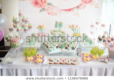 Candy bar. Table with different sweets for party Stock photo © ruslanshramko