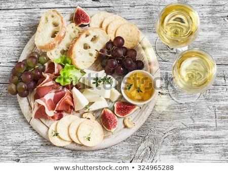 ストックフォト: 前菜 · ワイン · チーズ · プレート · ブドウ · 光