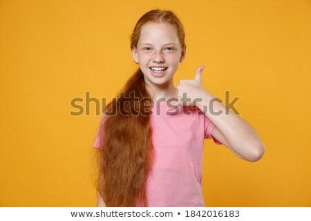 Vörös hajú nő tinilány készít telefonbeszélgetés kézmozdulat emberek Stock fotó © dolgachov