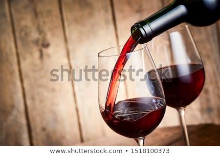 close up of wine bottles in dispenser at bar Stock photo © dolgachov