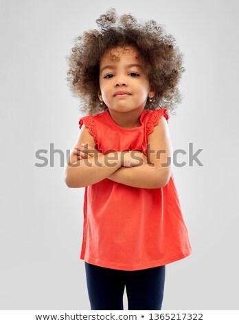 недовольный мало афроамериканец девушки серый детство Сток-фото © dolgachov
