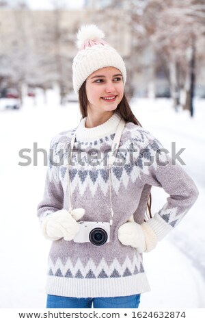 Close-up portrait of a woman in a white hat and white woolen sweater Stock photo © ElenaBatkova