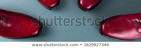 Banner of Red oxford shoes on blue background. Stock photo © Illia