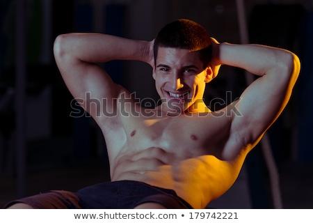 Smiling Men Doing Abdominal Excerise Stock photo © Jasminko