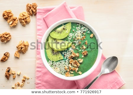 Clean eating and detox concept. Green vegan smoothie in bowl. Sprouted seeds around. Healthy green o Stock photo © vkstudio