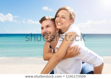 Outdoor portret knappe man geven op de rug vrouw Stockfoto © vkstudio