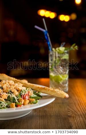 Salada de frango foguete tomates cereja fumado queijo Foto stock © boggy