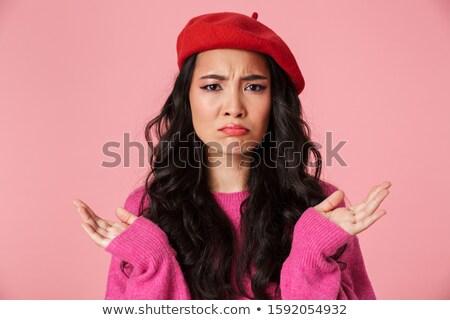 Image of perplexed beautiful asian girl wearing beret throwing u Stock photo © deandrobot