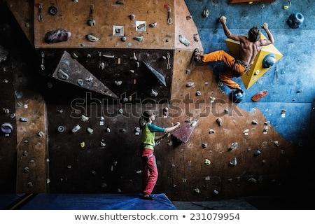 Muscular man practicing rock-climbing on a rock wall indoors BANNER, LONG FORMAT Stock photo © galitskaya