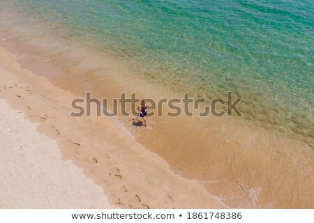Runner esecuzione spiaggia Ocean donna Foto d'archivio © Maridav