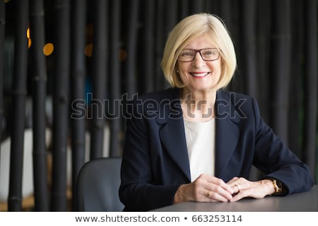 Friendly attractive blond business woman. Stock photo © lithian
