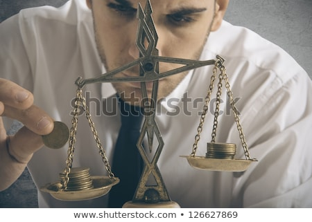 businessman weighs stock photo © goryhater