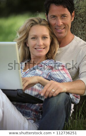 married couple leaning against tree stock photo © photography33