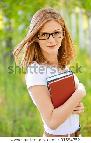 Young Female Reading With Head Resting On Books Stock photo © williv