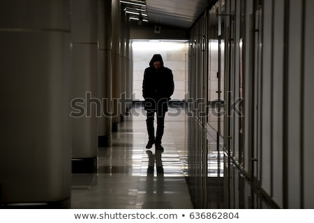 Young man walking down an empty corridor Stock photo © photography33