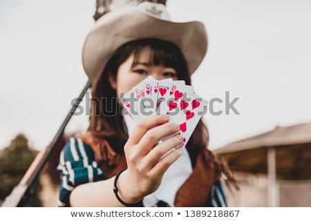 Pretty girl with poker cards  Stock photo © carodi