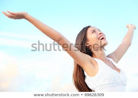 örömteli nő karok a magasban tengerpart piros bikini Stock fotó © dash